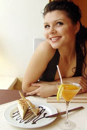 Girl in a restaurant interior. Served table. photo