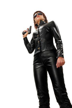 mujer policia: Seguridad ni�a con arma de fuego. Aislado en blanco.  Foto de archivo