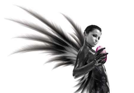 Sexy dark angel with the magic sphere. Isolated on white. Stock Photo - 2223301