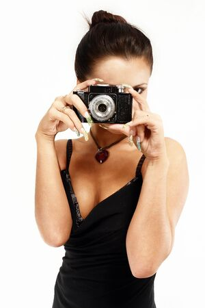 Sexy girl with old photo camera taking a shoot. photo