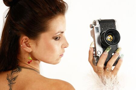 Sexy girl with old photo camera. photo