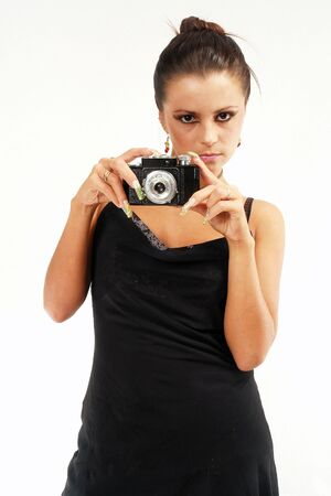 Sexy girl with old photo camera watching you. photo