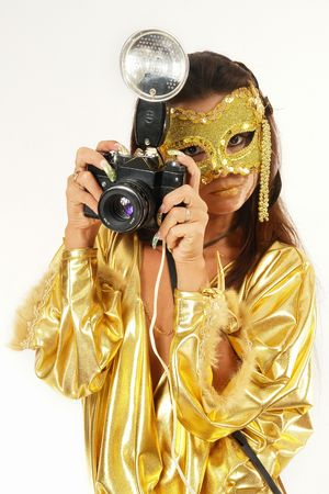 Sexy girl in golden mask & dress with old photo camera. photo