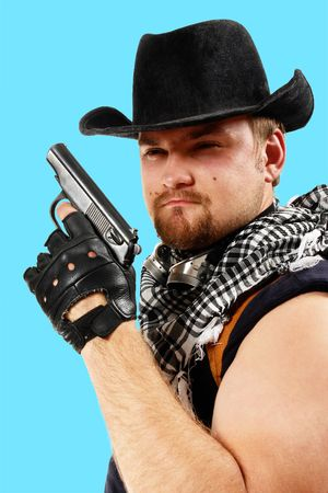 Sheriff in cowboy hat with a gun. Isolated on blue. Stock Photo - 3128710