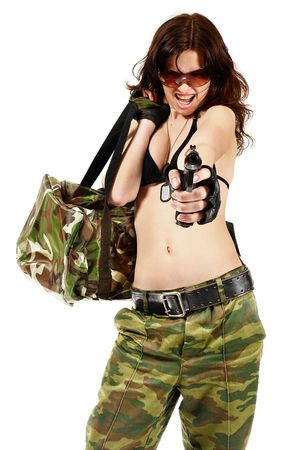 camouflage woman: Thief girl in camouflage pants with a gun and big  bag full of money.