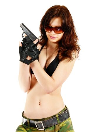 camouflage woman: Thief girl in camouflage pants with a gun. Isolated on white. Stock Photo