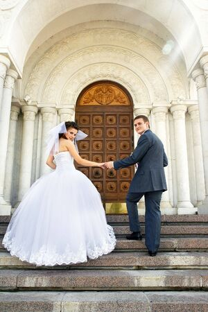 Bride with the groom near the entrance to the church Stock Photo - 3296065