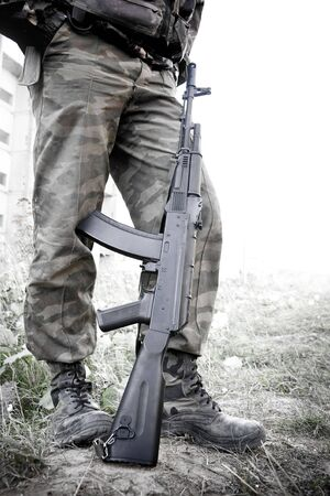 peacemaker: Russian peacemaker with russian machine gun in ruined city in Osetia . Stock Photo