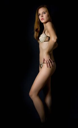 Pretty girl  in underwear in the dark room photo