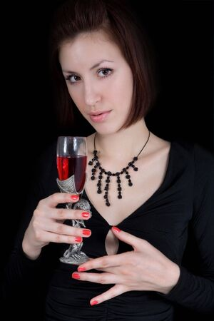 Pretty girl with the wineglass of red wine. photo