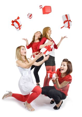 Pretty girls are catching the presents. Isolated on white. Stock Photo