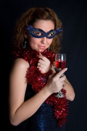Pretty girl  in the black dress with th wineglass in hands photo