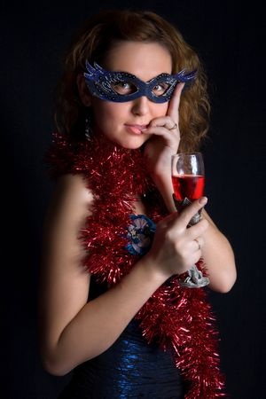 Pretty modest girl is holding the wineglass photo