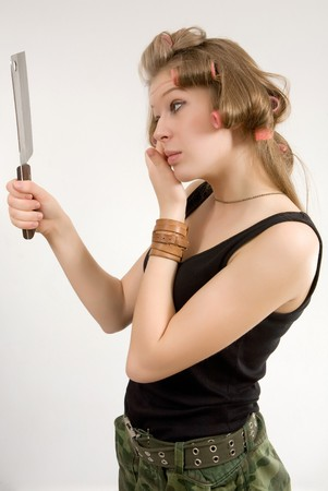 curled lip: Pretty girl with the big cooking knife. Stock Photo