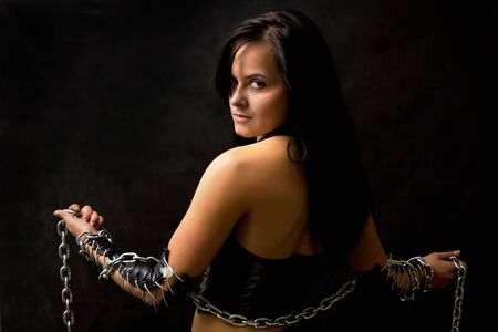 Pretty sexy woman with long metal chain Stock Photo - 4100086