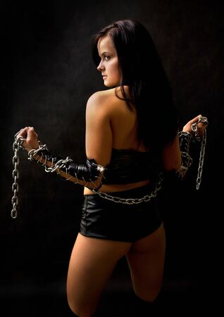 Pretty sexy woman with long metal chain Stock Photo - 4100087