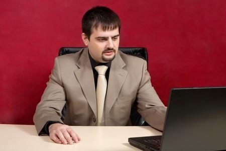 Portrait of businessman near laptop.  photo
