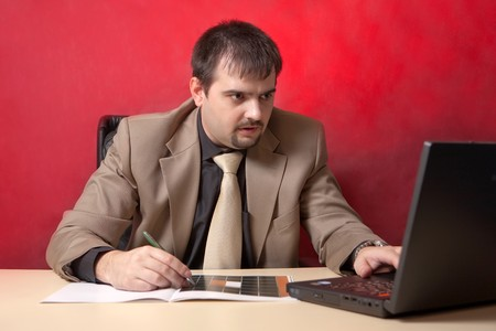 Portrait of businessman near laptop. Crysis theme. photo