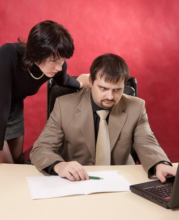 Portrait of businessman and businesswoman near laptop. Crisis theme. photo