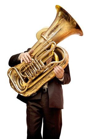Musician is playing on the golden tuba. Isolated on white. Stock Photo
