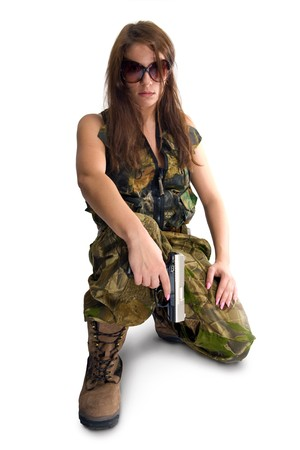 gangster background: Girl with a gun in camouflage clothing. Isolated on white. Stock Photo