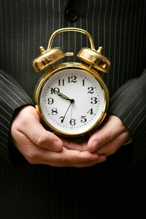 Retro-styled alarm clock in the arms of a businessman Stock Photo - 4313978