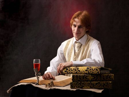 Portrait of handsome man with the glass of wine. photo