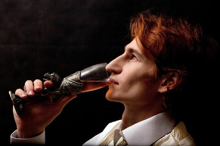fop: Portrait of handsome man with the glass of wine. Stock Photo