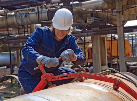 Yong worker in uniform is construction the trunk pipeline photo