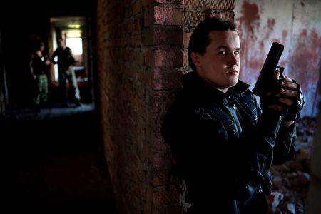 sicario: Hitman con un arma de fuego est� a la espera de v�ctimas.