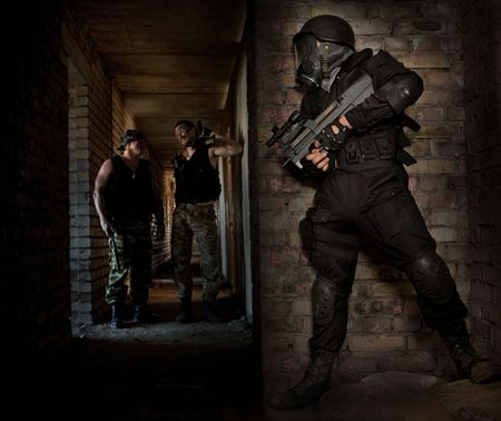 hitman: Hitman in a mask with the machinegun is waiting for victims Stock Photo