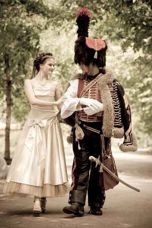 cavalryman: Russian hussar in vintage outfit with pretty woman.