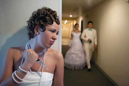 unfaithful: Pretty bride with the knife is waiting for unfaithful husband.