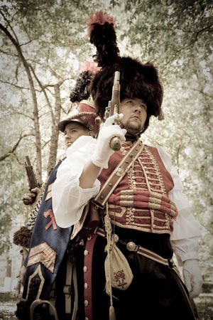 duelling: Duelling hussars on the garden background. Retro-styled photo. Stock Photo