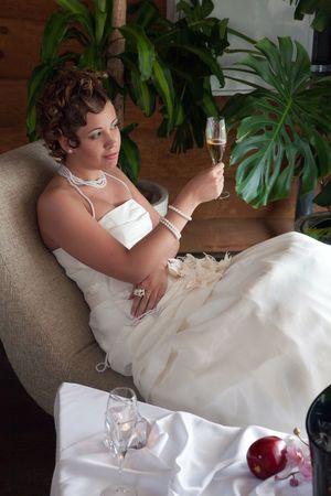 Pretty bride with the glass of champaigne photo