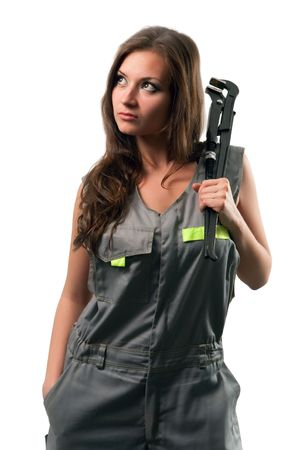 dungarees: Pretty plumber with the adjustable wrench. Isolated on white. Stock Photo