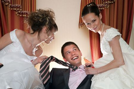 Two brides are sharing one sexy groom.