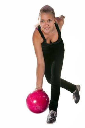 Pretty bowler with the red ball. Isolated on white. Stock Photo
