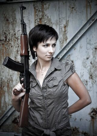 Portrait of a woman with the machine gun. photo