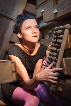 Pretty woman with the vintage abacus in ruined office Stock Photo - 5620655