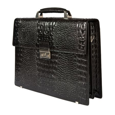 Black exclusive suitcase made from crocodile leather. Isolated on white. photo
