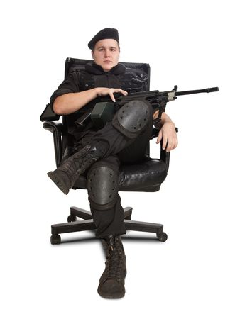 arm chairs: Sitting soldier with the machine gun. Isolated on white.