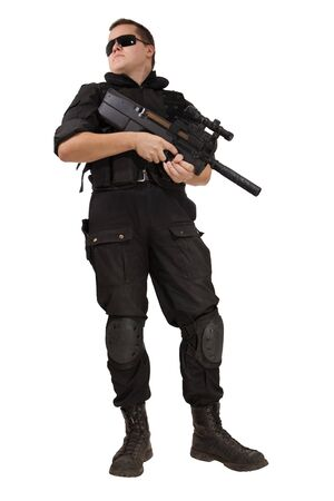 Armed man in NATO uniform with the machine gun. Isolated on white. photo