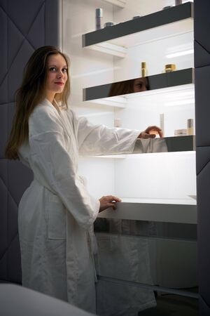 highlighted hair: Girl in the bathrobe on the highlighted shelves background