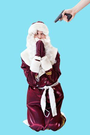 pitiful: Pitiful Santa on knees. Isolated on blue.