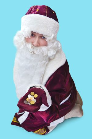 Poor Santa with the coins on the hand. Focus point on the face. Isolated on blue. photo
