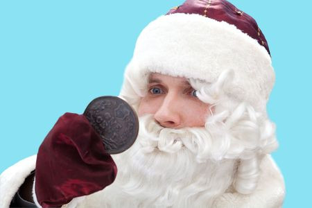 Poor Santa with the one cent coin. Isolated on blue. photo