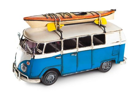 Metal toy minibus with the attached kayak on the top. Isolated on white.