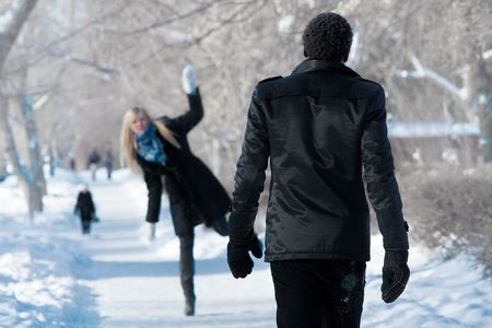Winter rendezvous of a romantic multi-etnic couple in the winter park photo