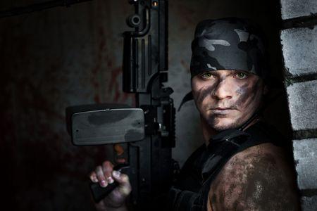 Powerful mercenary with submachine gun